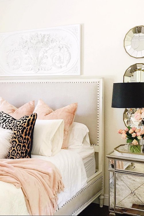 Hamptons bedroom decor with feminine styling including leopard print pillow