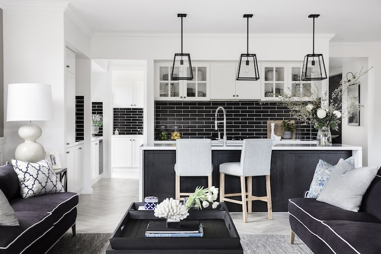 Hamptons home kitchen with black tile splash back in the Boston 36 display home by Clarendon Homes